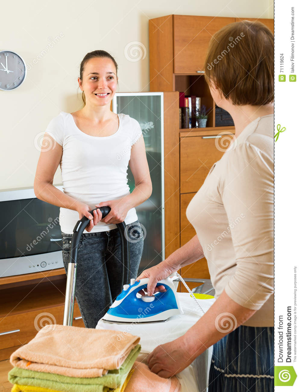 Mature Woman And Girl Cleaning At Home Stock Photo Image Of