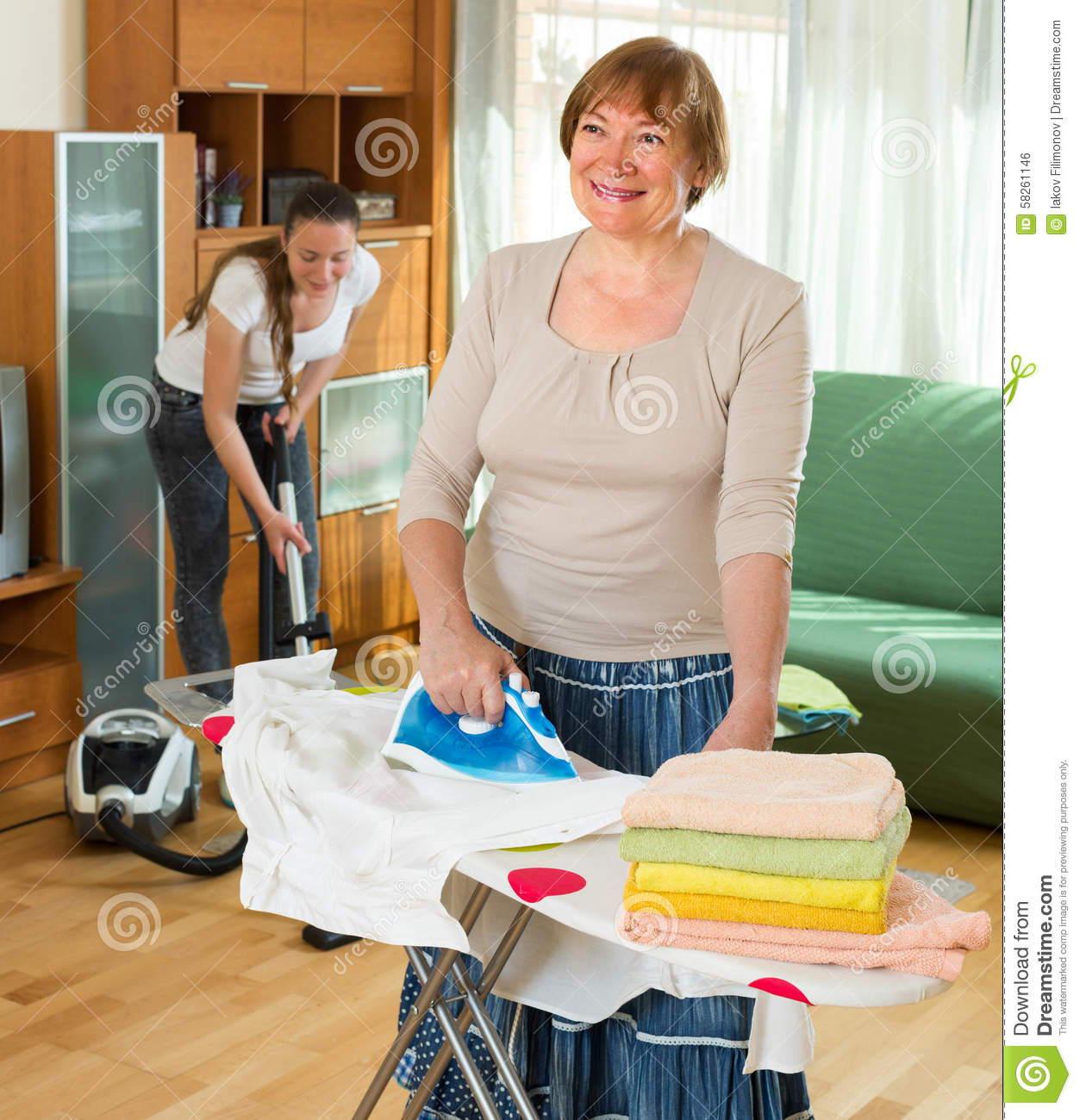 b358a40de4 Mature Woman And Girl Cleaning At Home Stock Photo - Image of living ...