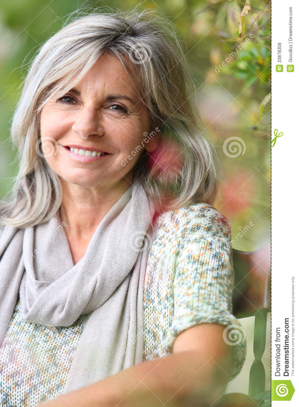 mature woman with gray hair sitting outdoor stock image - image of