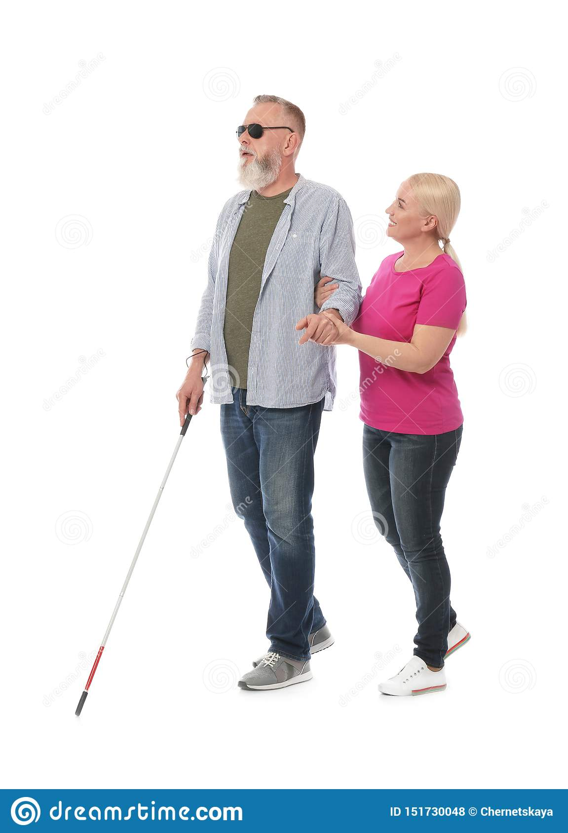 Mature woman helping blind person with long cane