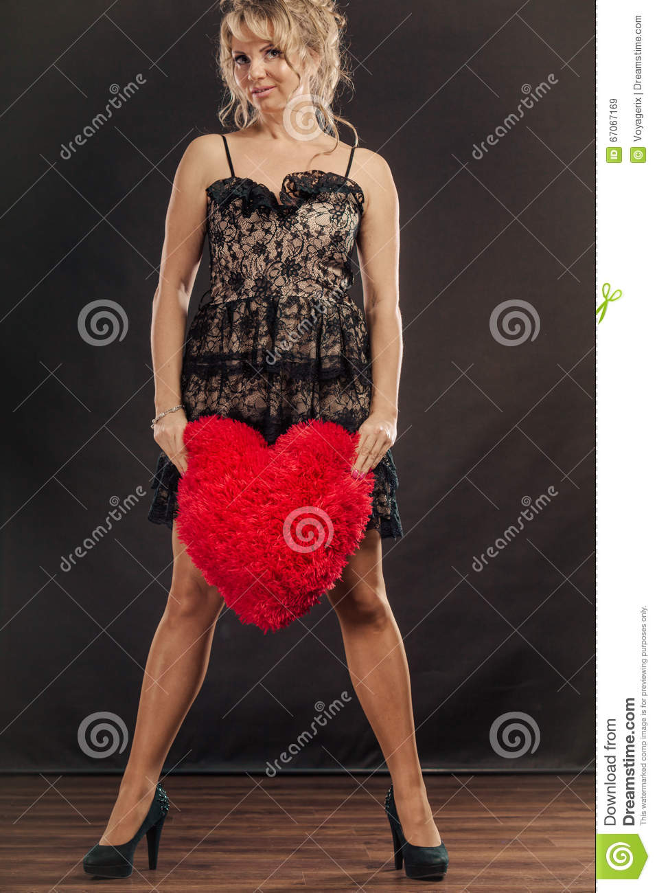 mature woman holds big red heart stock image - image of love