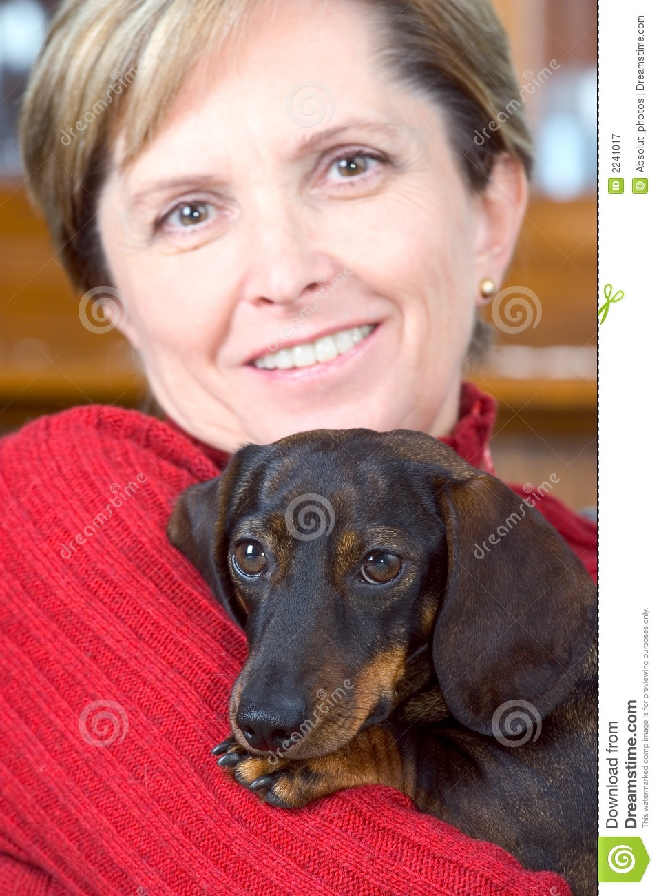 Mature woman holds dog
