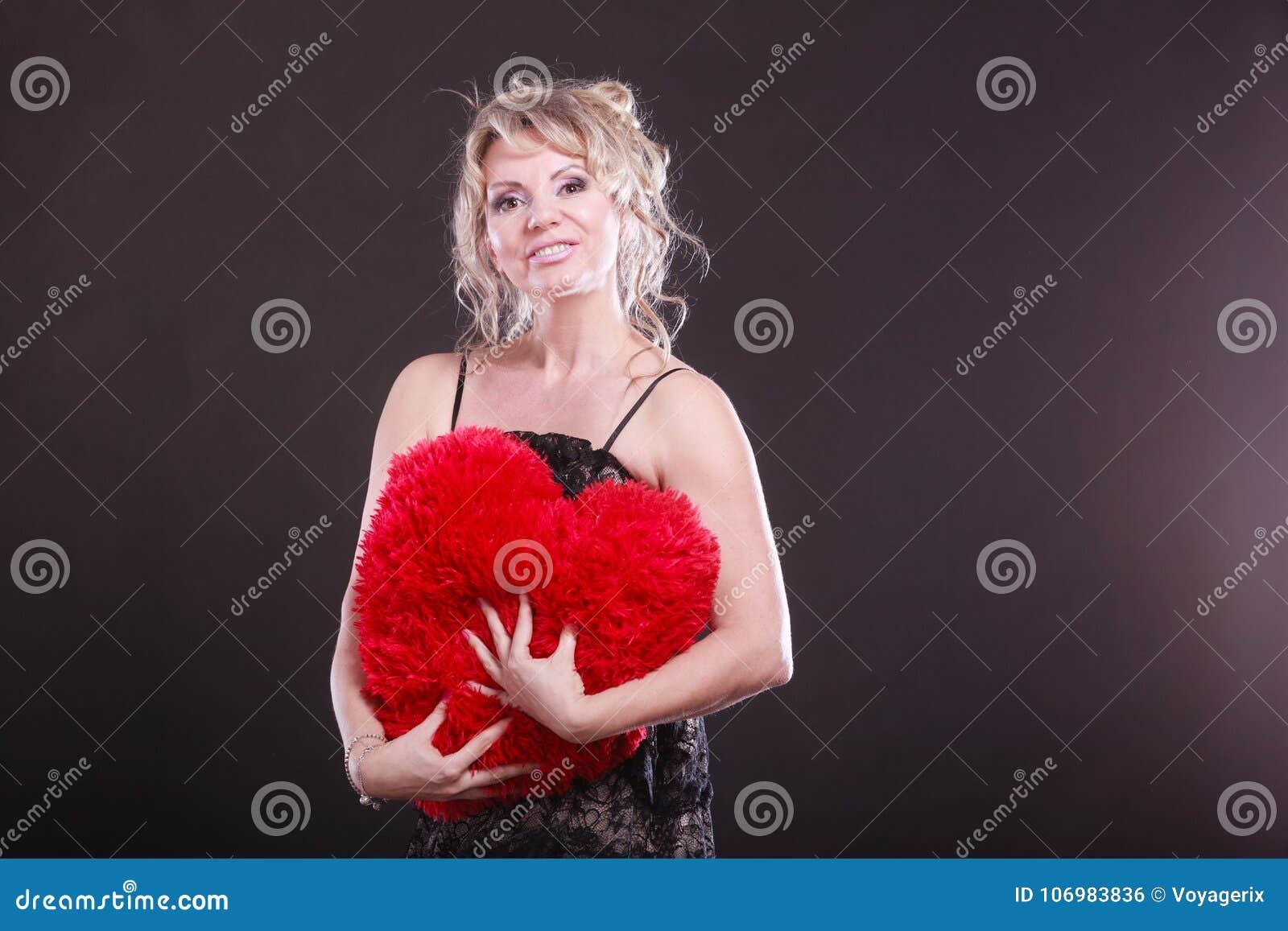 mature woman hug big red heart stock photo - image of gift