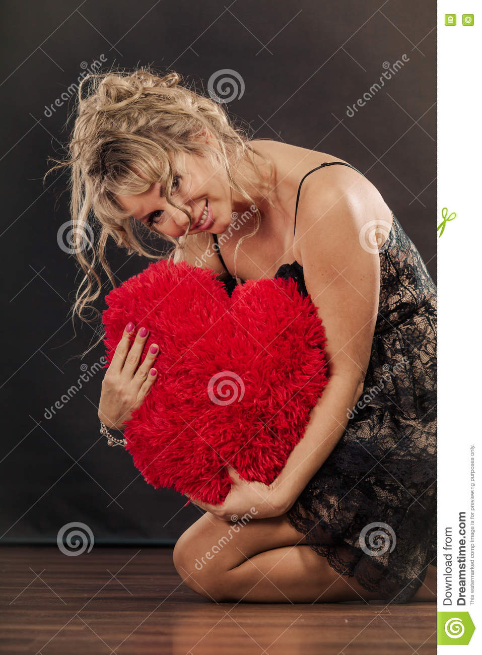 mature woman hug big red heart stock image - image of girl, model