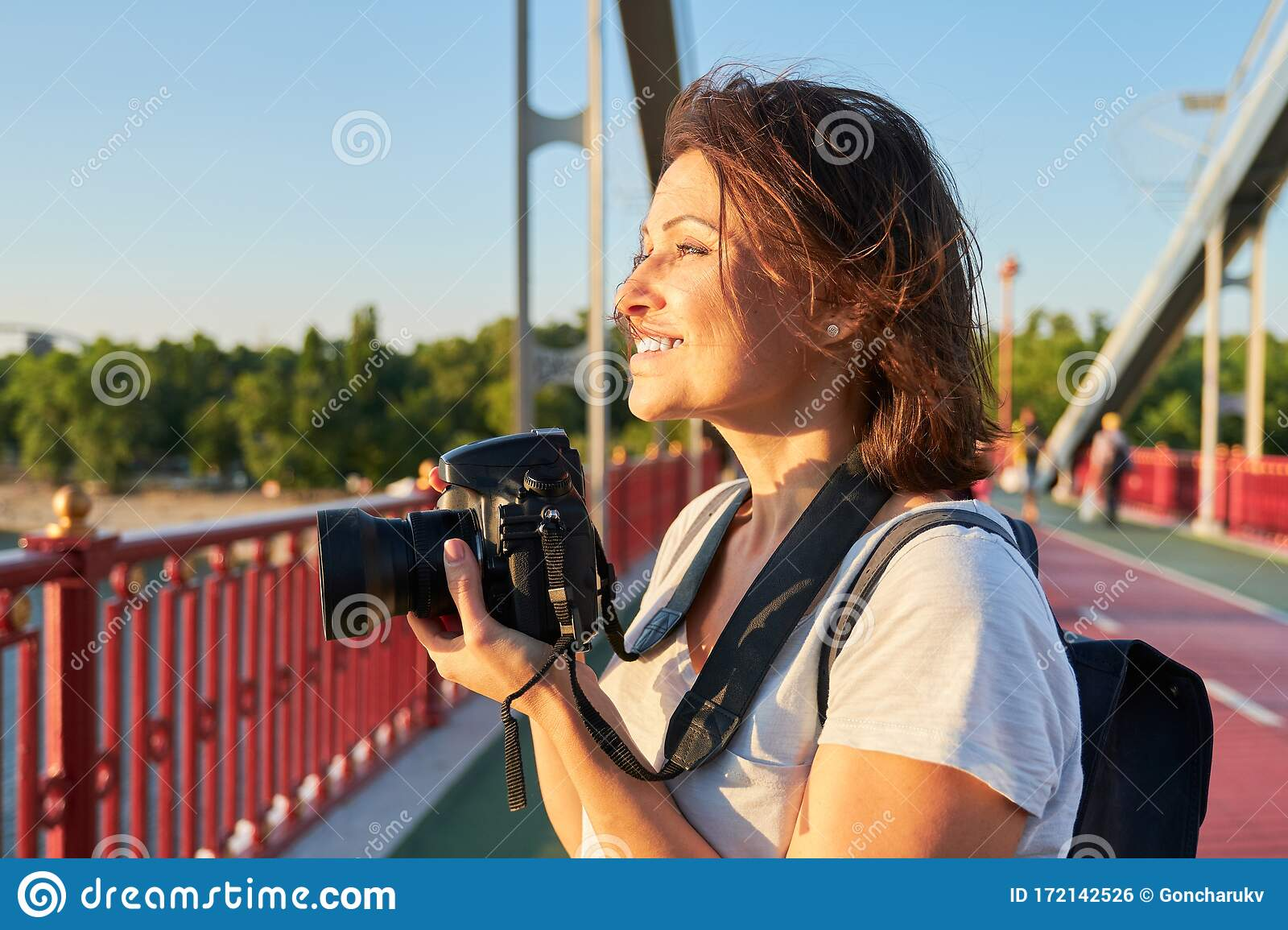 Mature Woman Photographer With Camera Taking Photo Picture Stock
