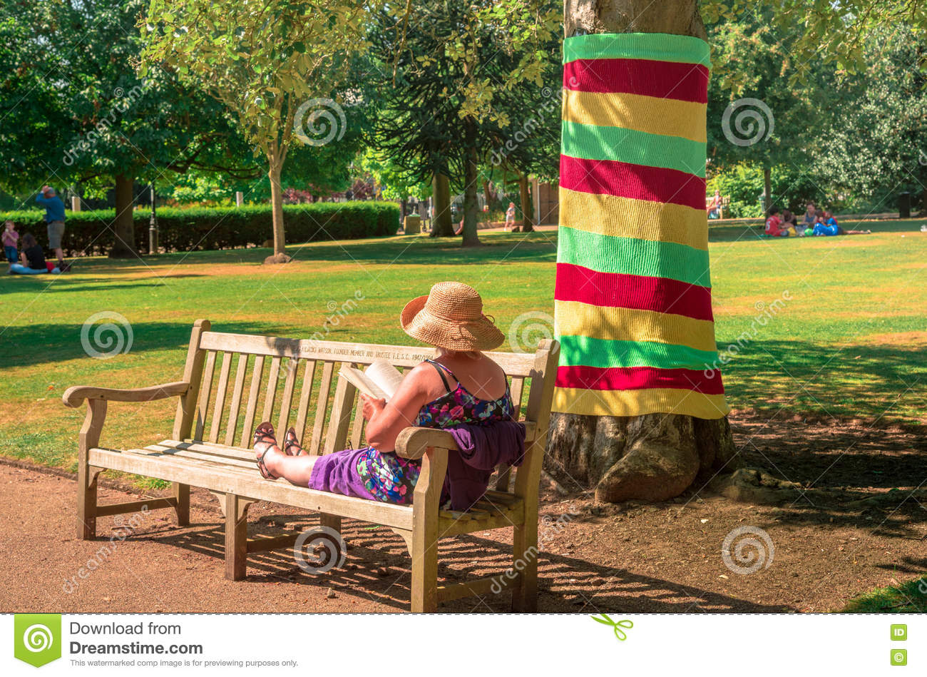 Mature woman relaxing in a sunny day in a park of UK