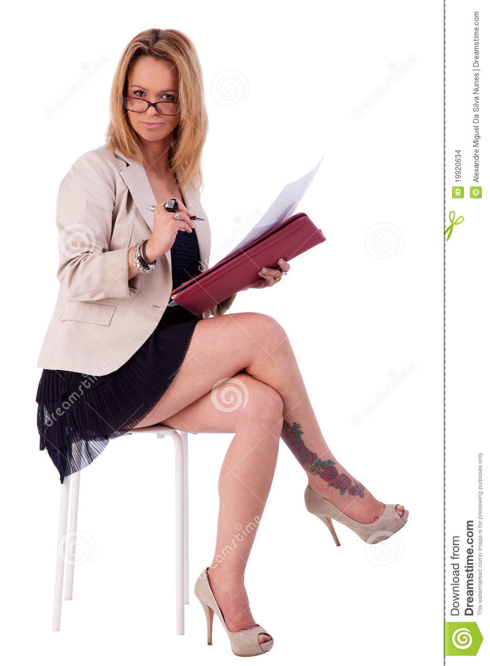mature woman, secretary seated on a bench, reading stock photo
