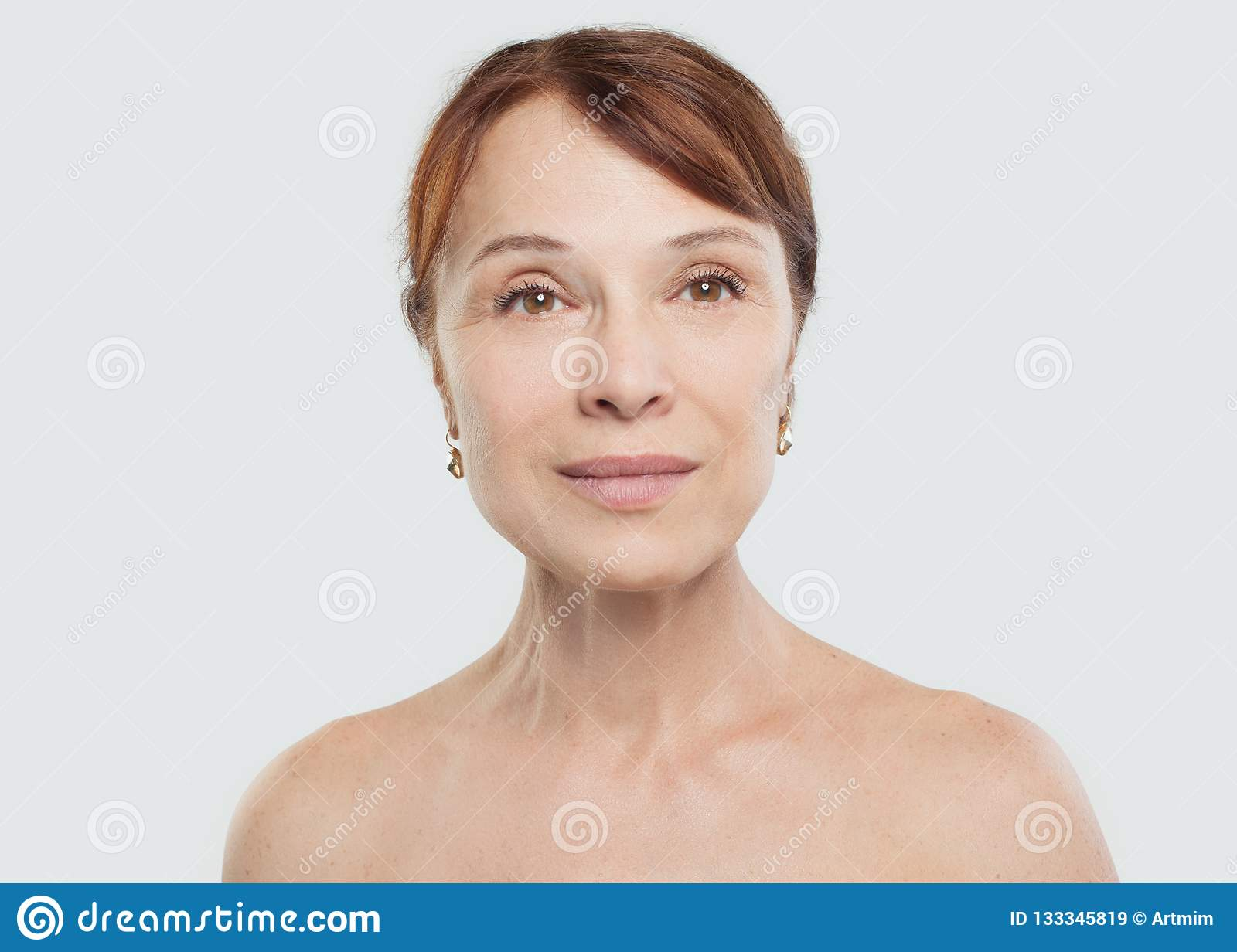 Mature woman smiling. Beautiful mid adult female face