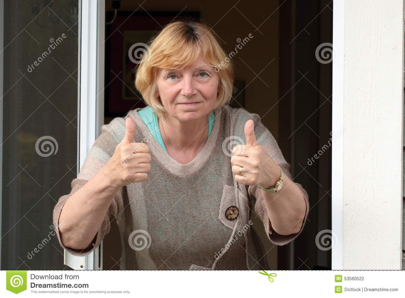 mature woman two thumbs up stock photo. image of human - 53560522