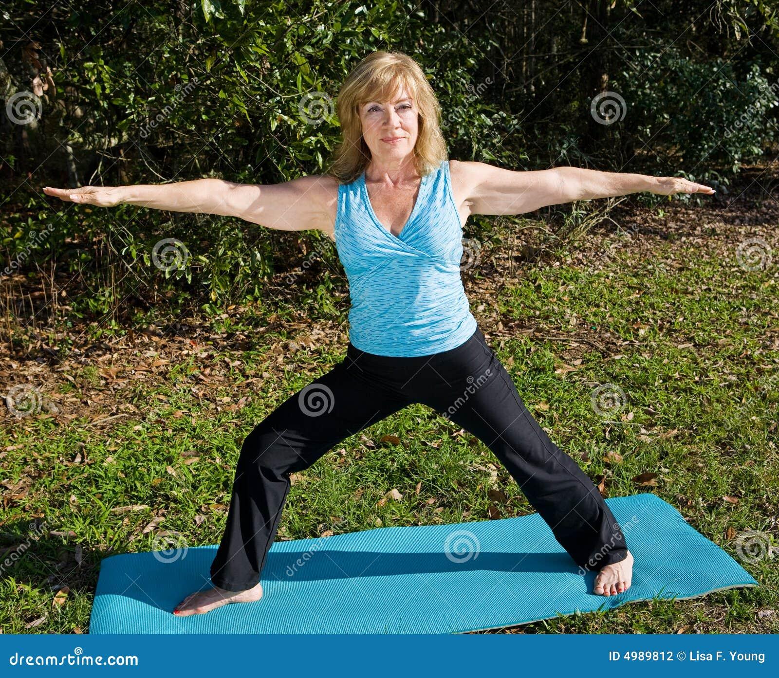 Mature Woman Yoga Warrior Pose Stock Photography Image
