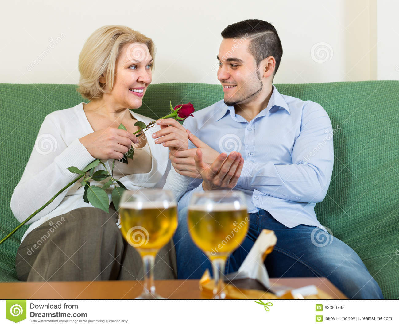 Mature Woman With Young Guy Indoors Stock Image - Image of ...