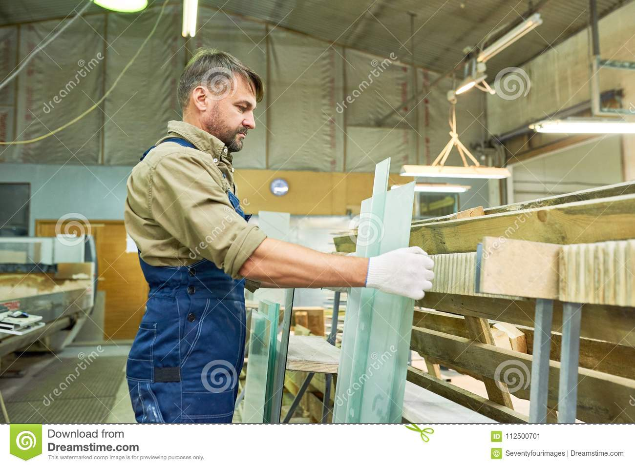 Mature worker at modern furniture factory