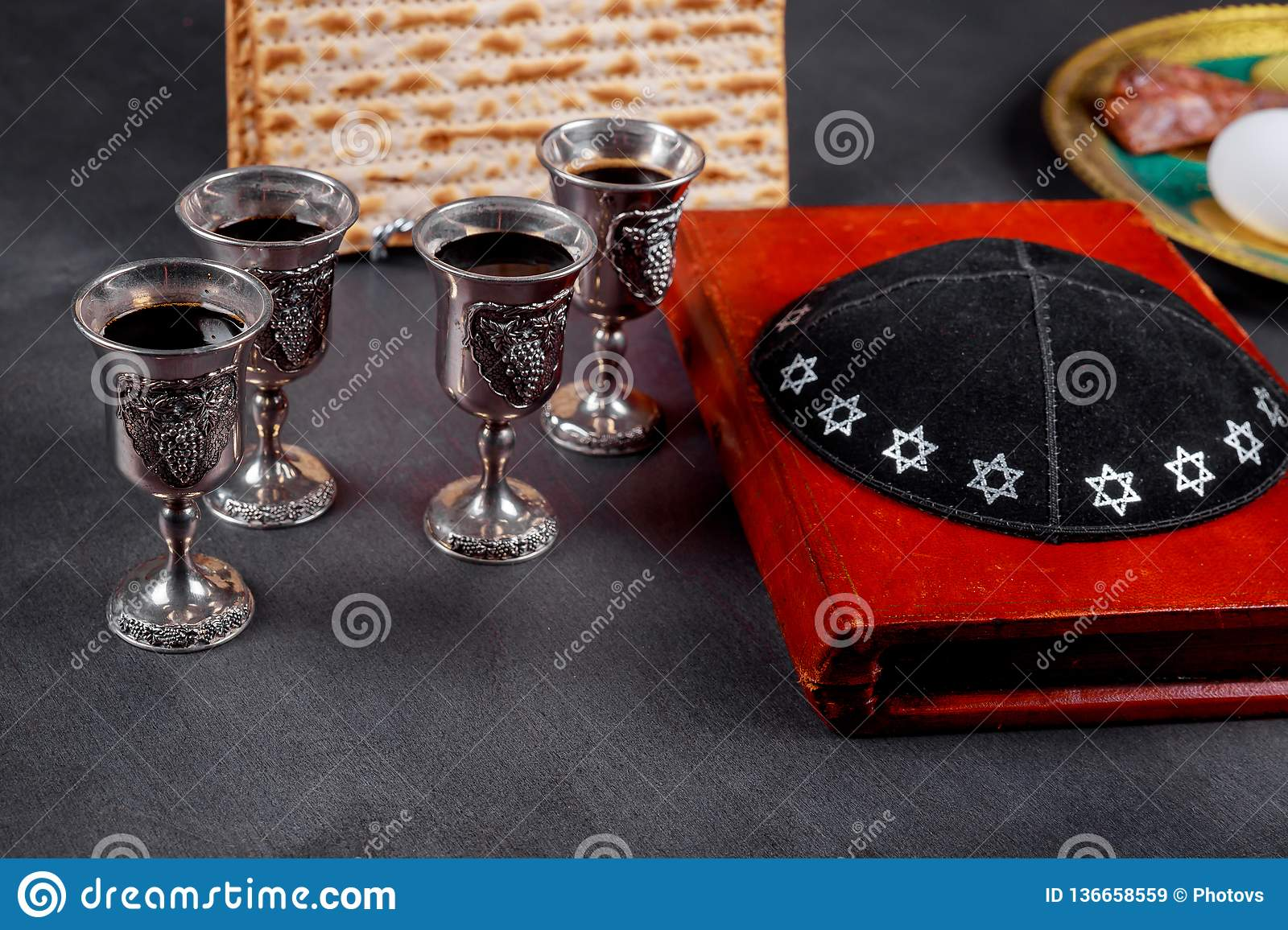 Matzot and four glasses red wine symbols of Passover