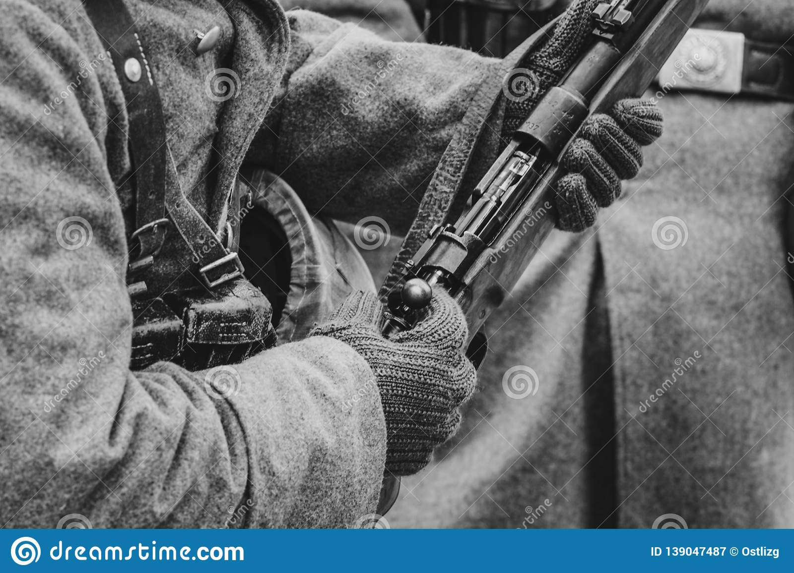 Mauser rifle in the hands of a German soldier. World War II