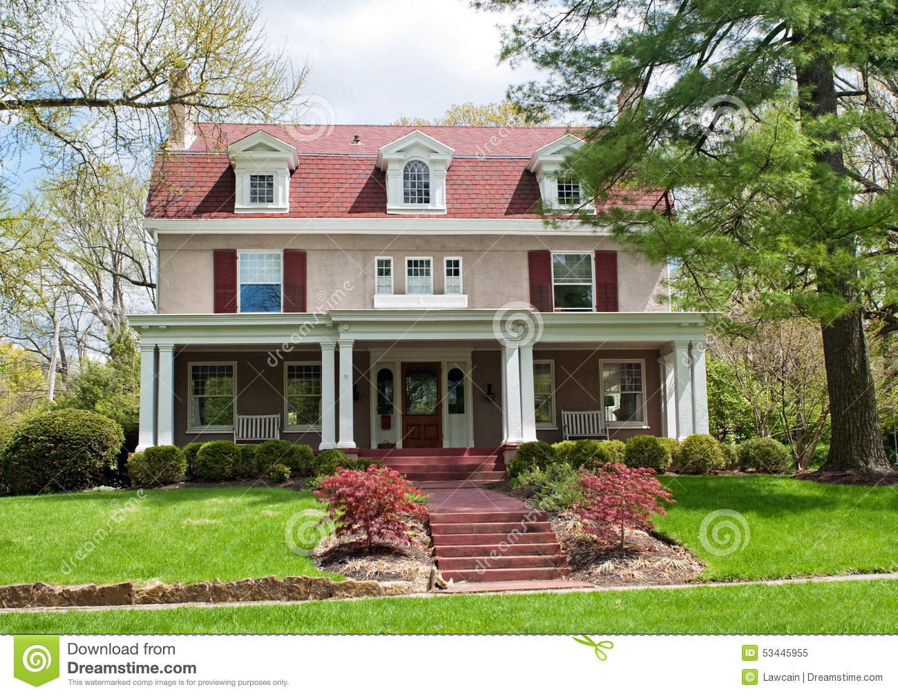 Mauve stucco house with burgundy accents stock photo for Accent tree for corner of house