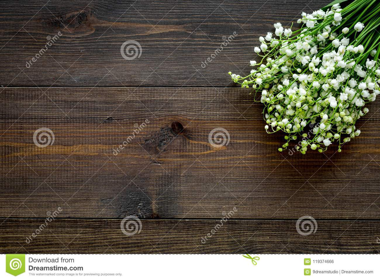 May flowers bouqet of lily of the valley flowers on dark wooden may flowers bouqet of lily of the valley flowers on dark wooden background top view izmirmasajfo