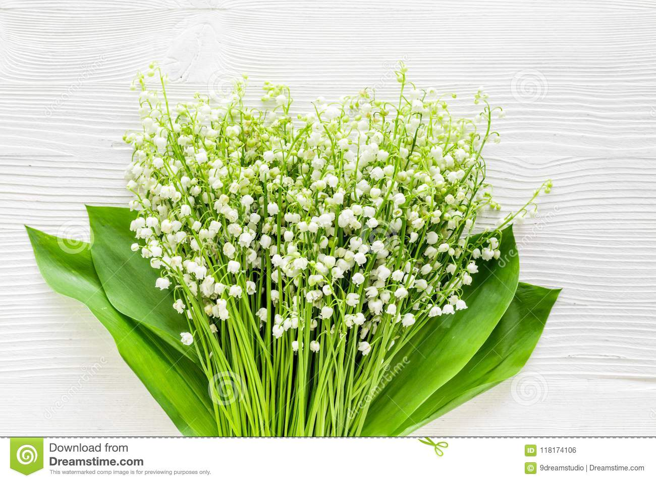 May flowers bouqet of lily of the valley flowers on white may flowers bouqet of lily of the valley flowers on white background top view copy izmirmasajfo