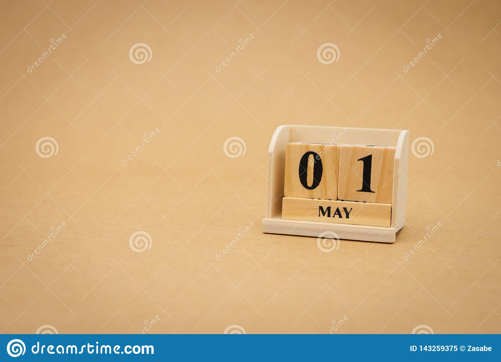 May 1st wooden calendar on vintage wood abstract background. International Labor Day Is a holiday for workers
