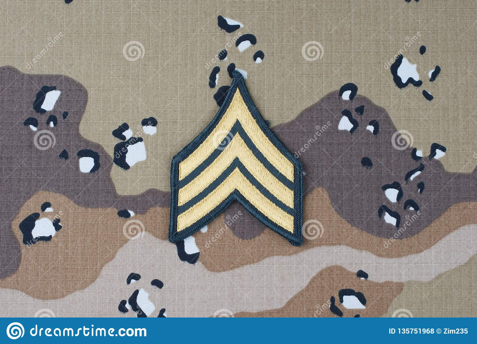 May 12, 2018. US ARMY Sergeant rank patch on desert camouflage uniform background