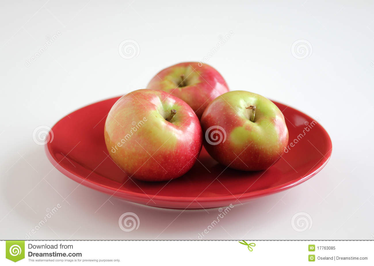 McIntosh Apples on Red Plate