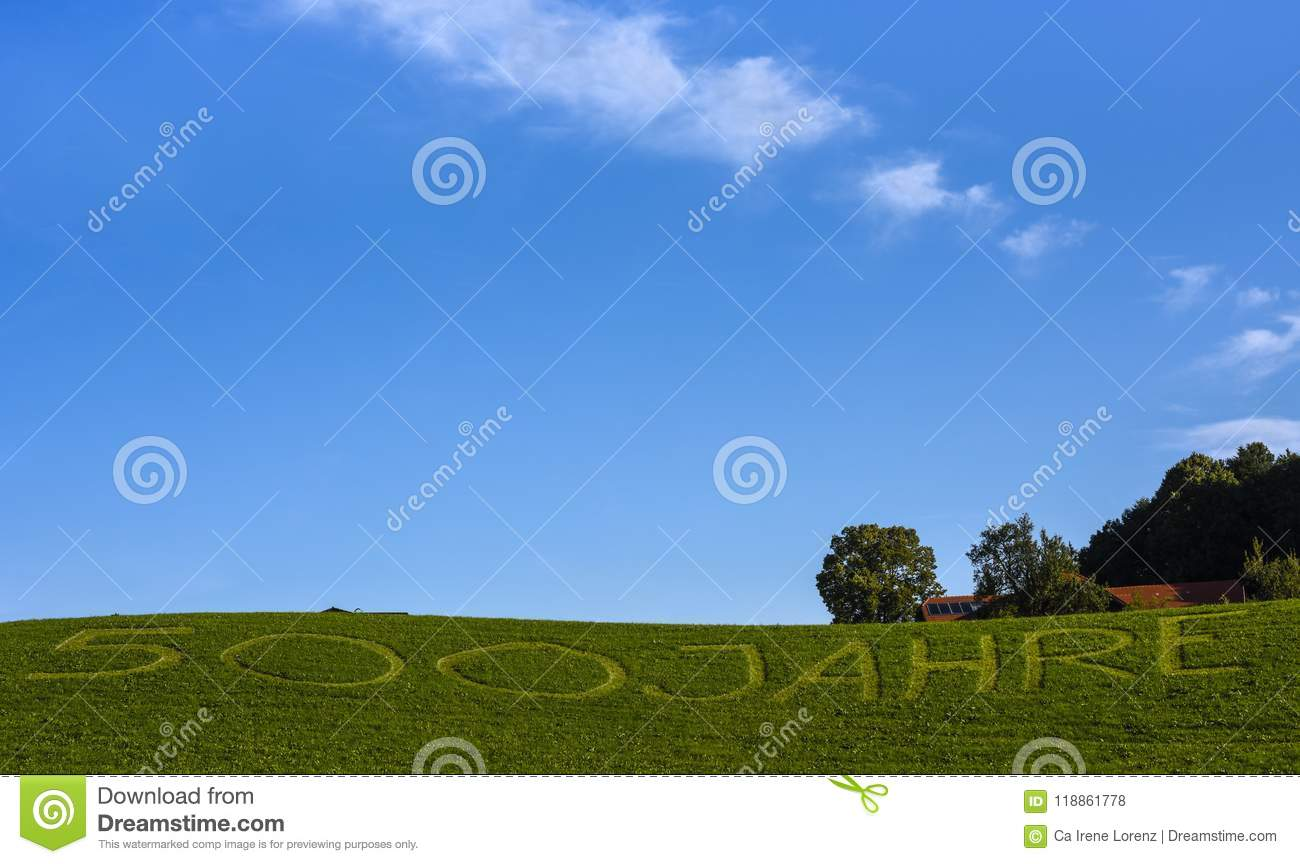 Meadow with lettering 500 years written in german language `500 Jahre`, Germany