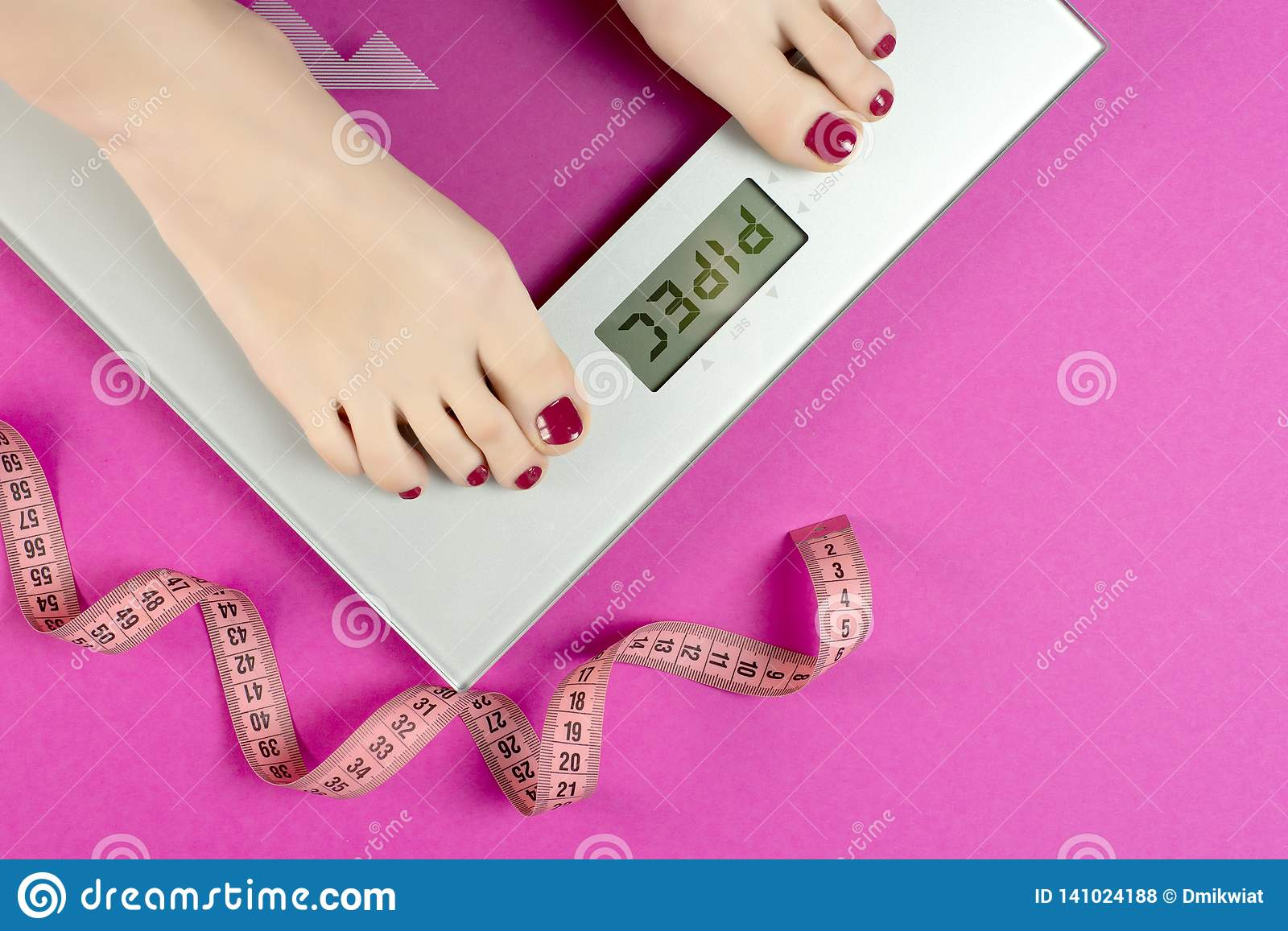 Measure tape and scales on a pink background with the words pipec. Diet plan and workout women before the summer season