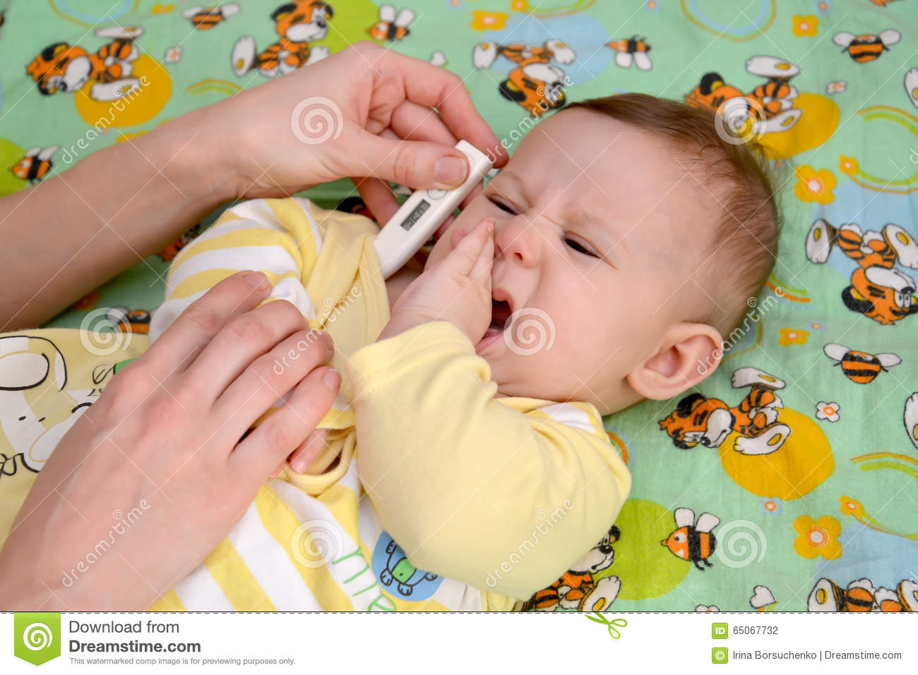 Measurement of temperature to the sick crying baby the electronic thermometer
