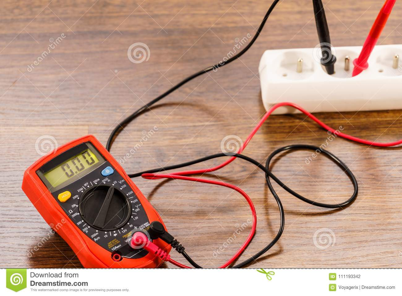 measurement voltage in electrical socket with multimeter stock photo