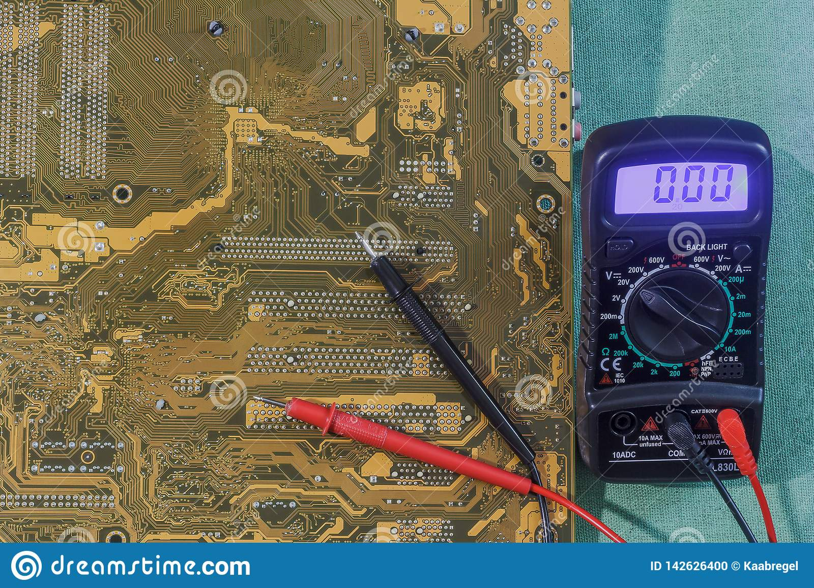 Measuring instrument multimeter with yellow-brown printed circuit board