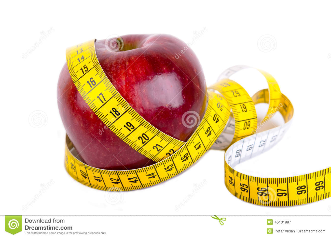 Measuring tape wrapped around a apple weight loss