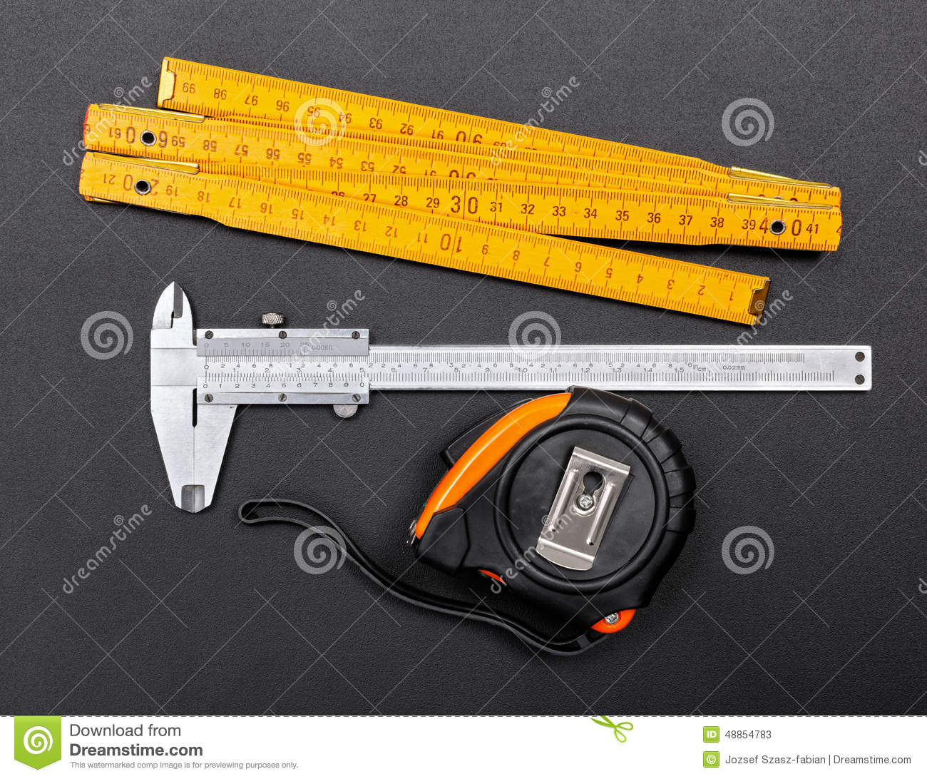 Time Measuring Instruments : Measuring tools on black ruler caliper and tape stock