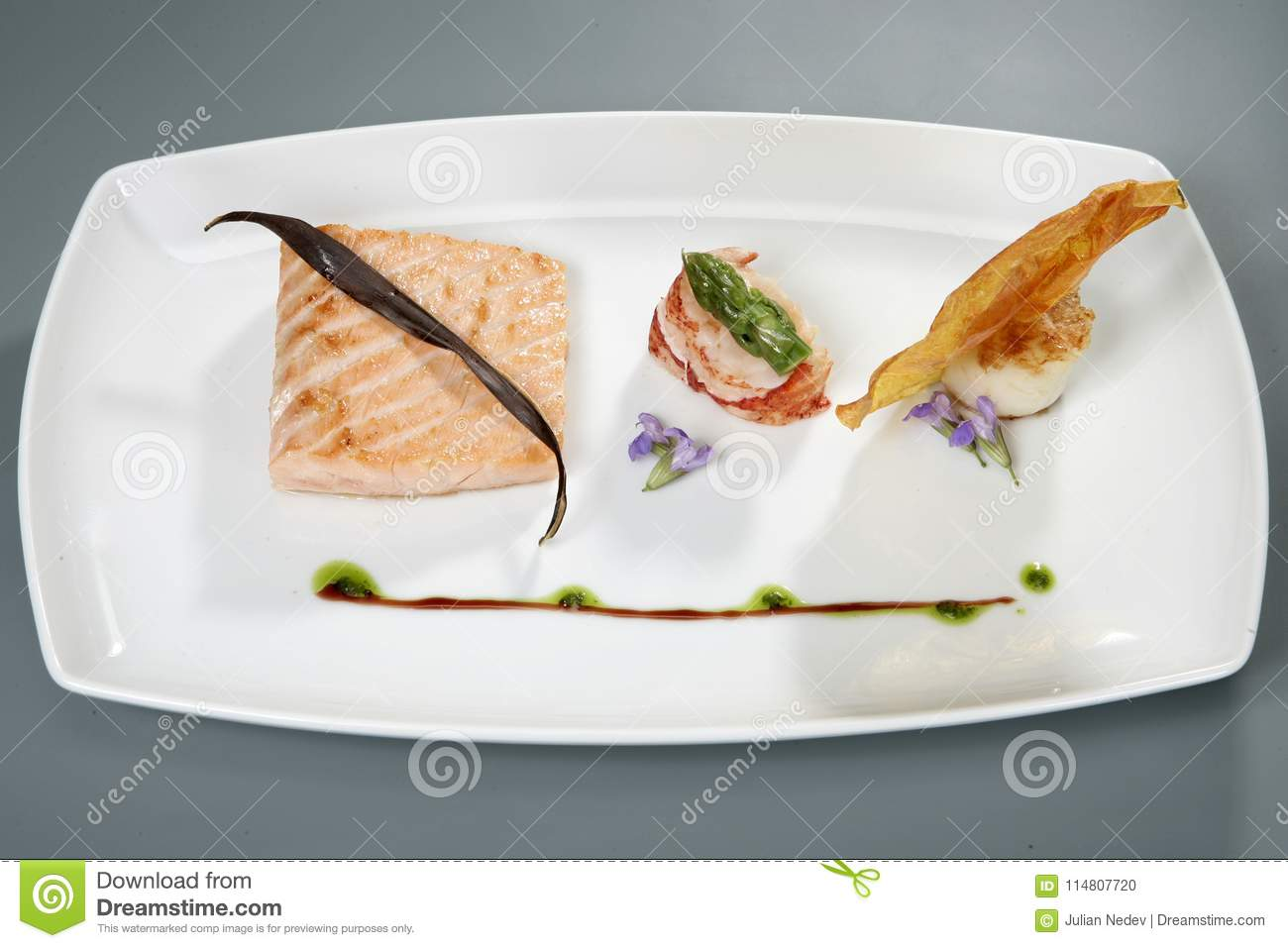 Meat With Decoration On White Plate Gourmet Food Stock Photo