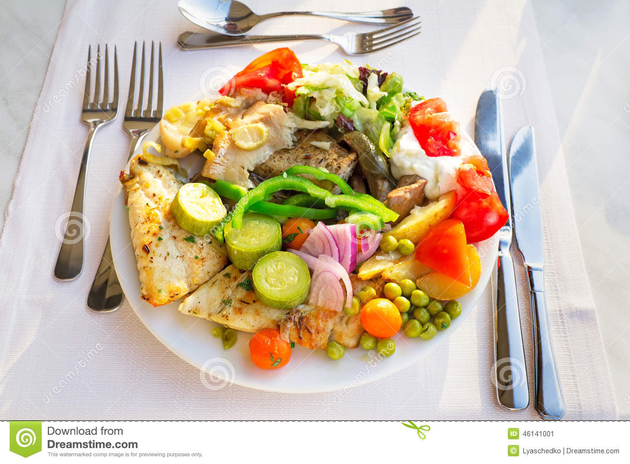 Meat fish and various vegetable garnish on a plate stock for What vegetables go with fish