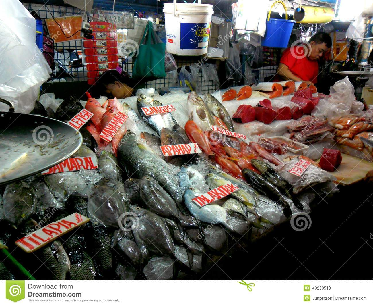Meat and fish vendor in a wet market in cubao quezon for Fish market prices