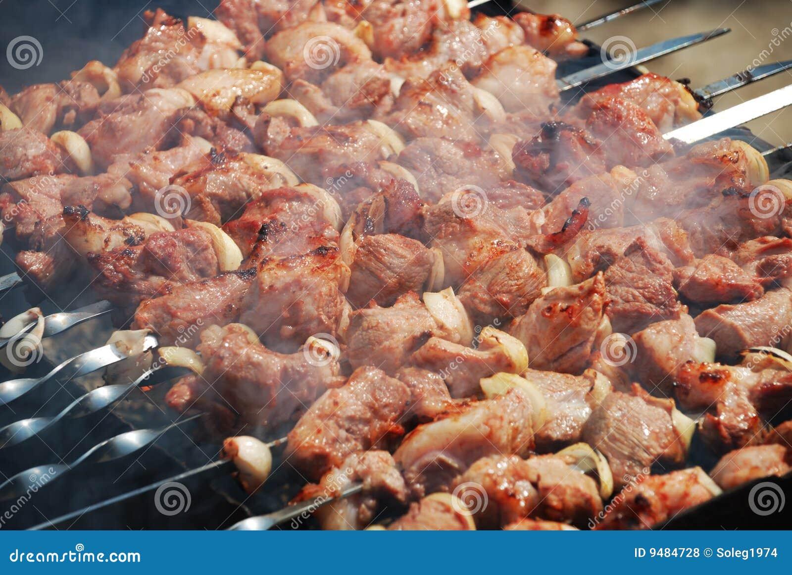 Meat is fried on fire
