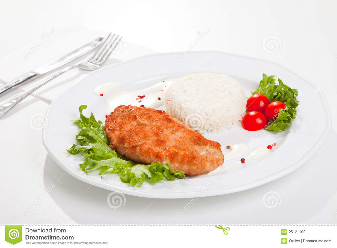 Delicious meat with mixed leaf salad an rice ready to eat on white ...