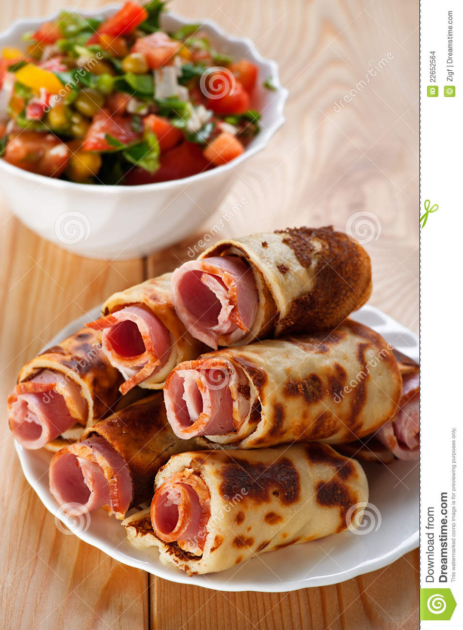 Meat rolls in the omelet, vegetable