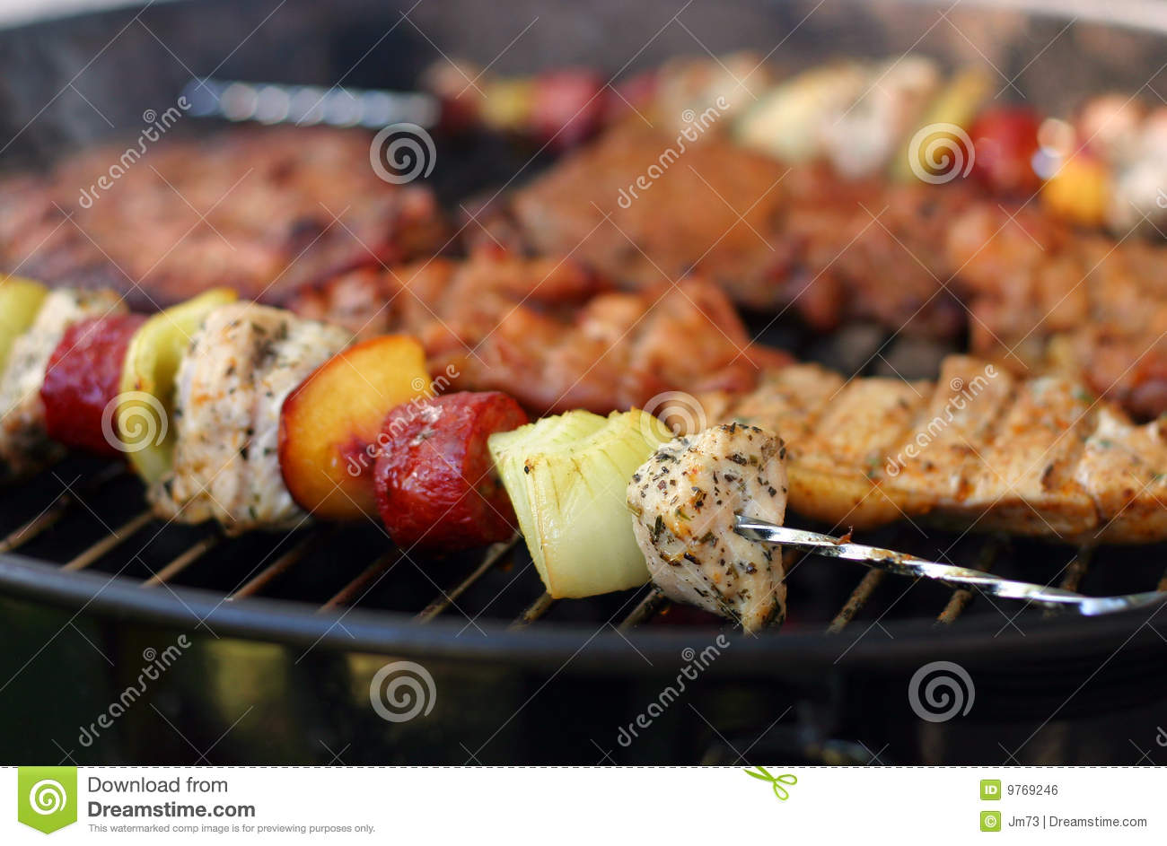 Meat and skewers on the grill