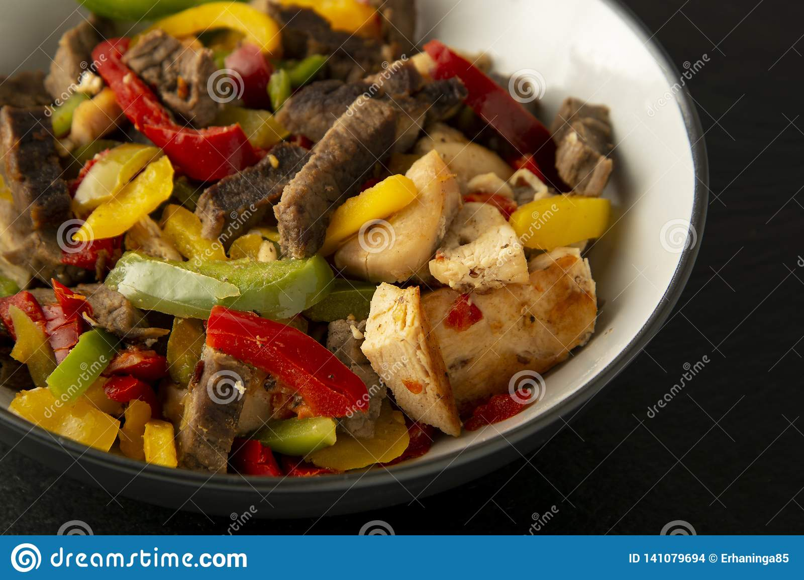 Fry Meat With Vegetables On Stone Slate Plates Dinner