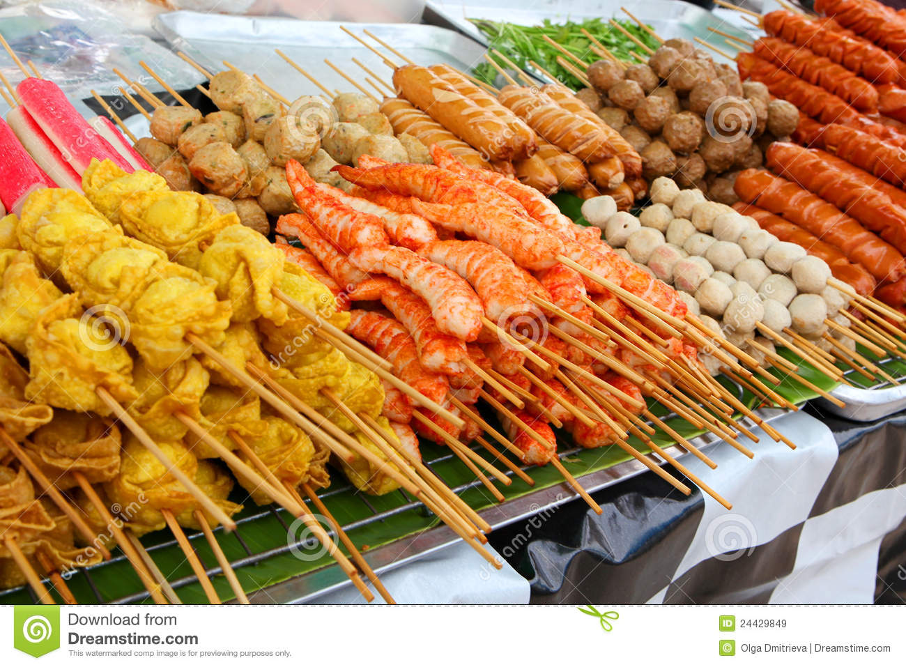 Meatballs and fried shrimps on sticks at a market in Phuket, Thailand.