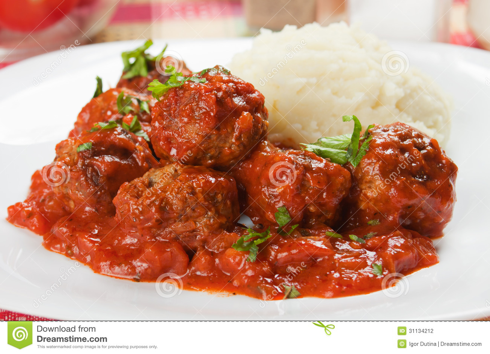 Meat balls with mashed potatoand tomato sauce.