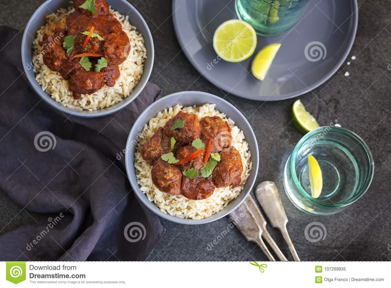 Meatballs in tomato sauce served on rice