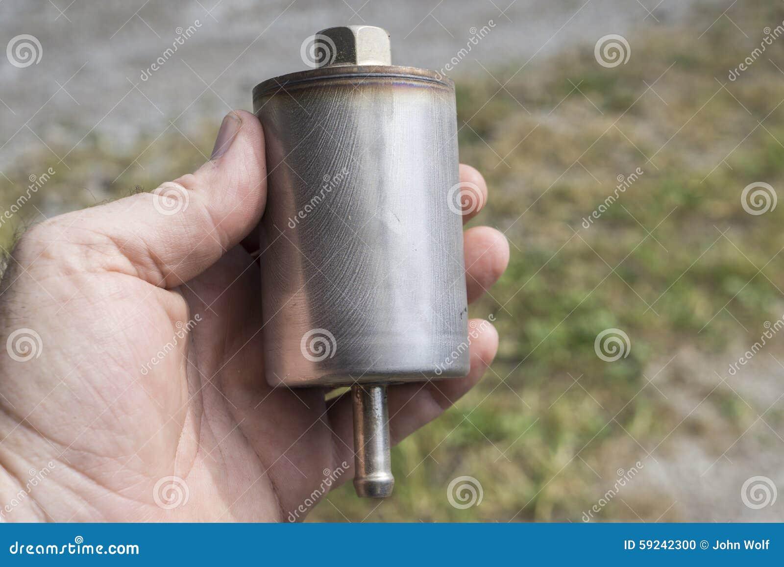 Download Mecánico Examining Un Nuevo Filtro Del Gas Foto de archivo - Imagen de grasa, mantenimiento: 59242300