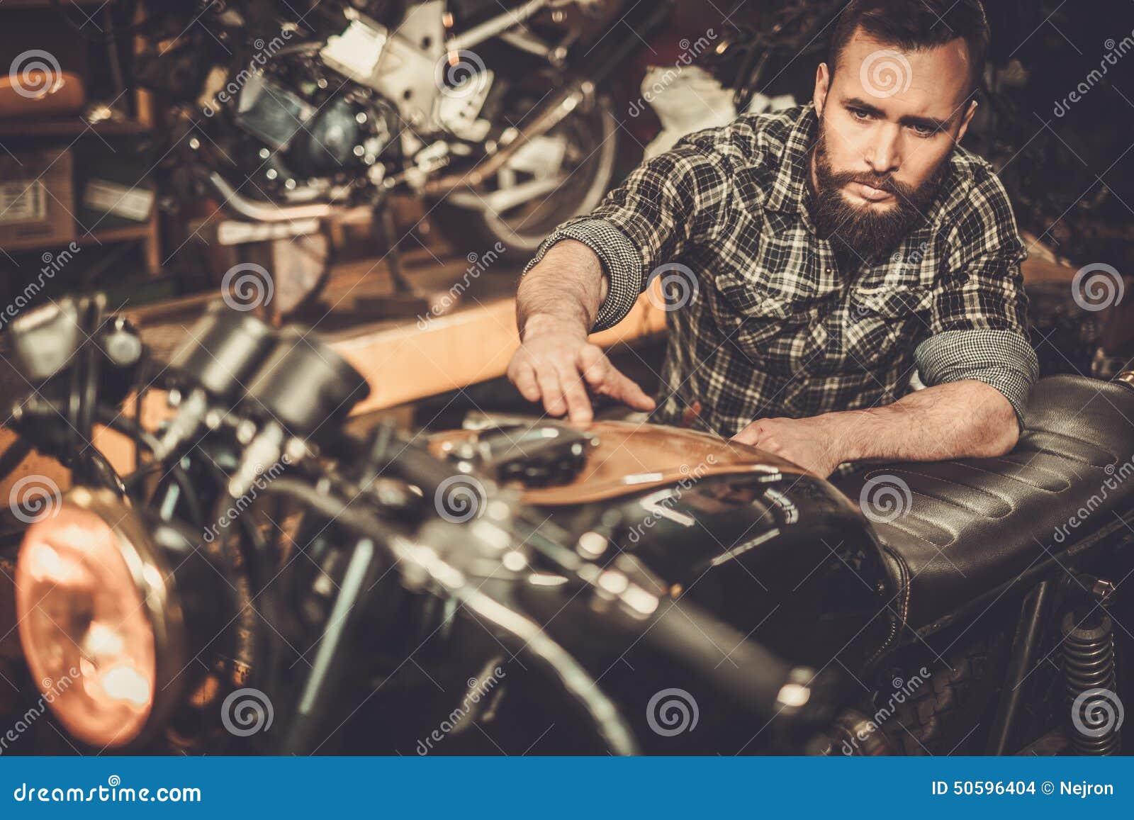 Mechanic building vintage style cafe-racer