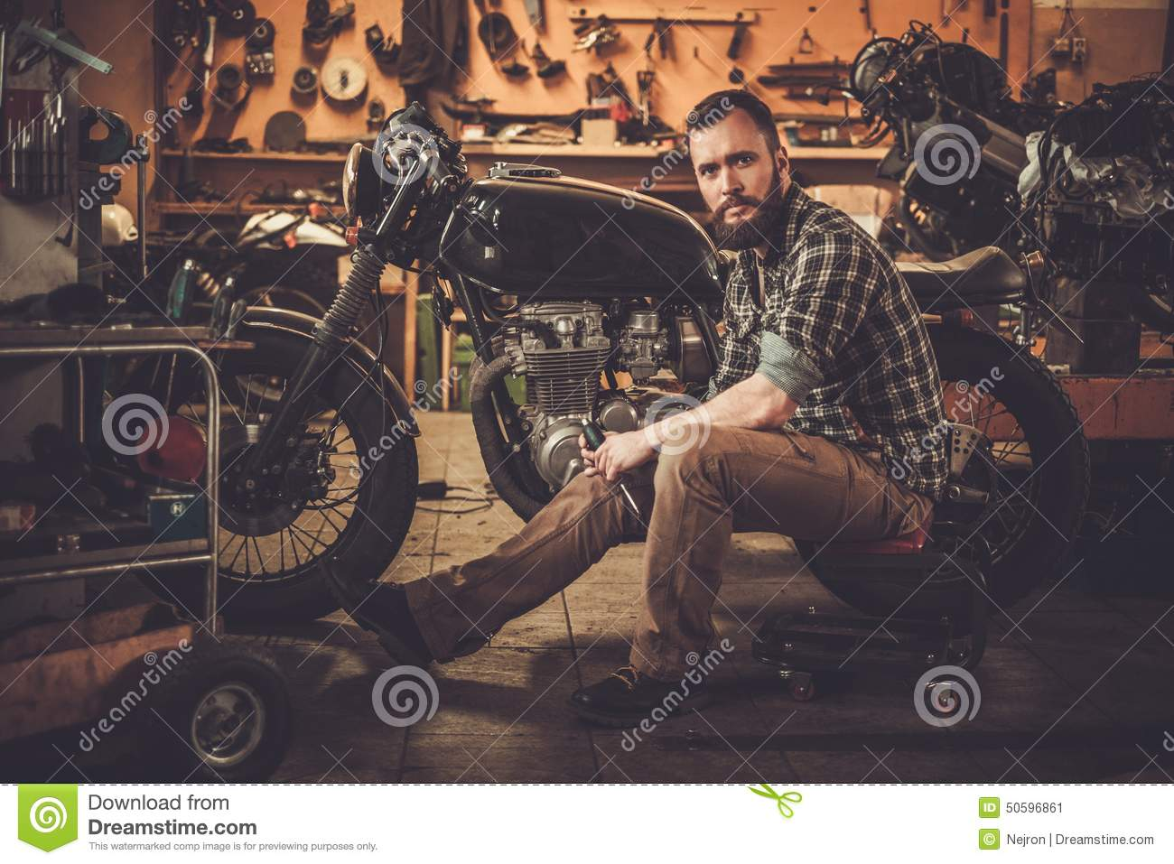 mechanic building vintage style cafe racer stock photo