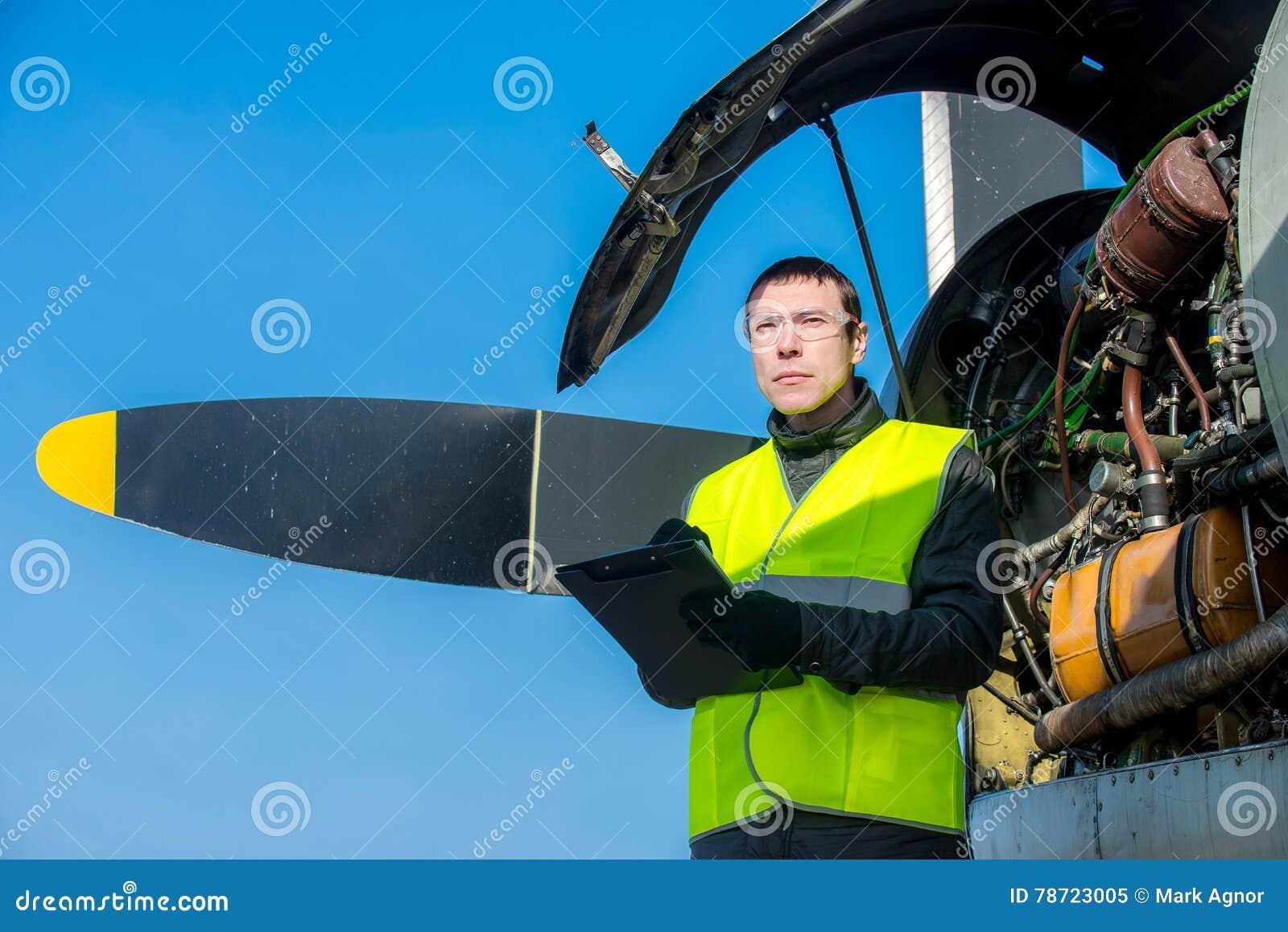 Mechanic checking airplane s engine