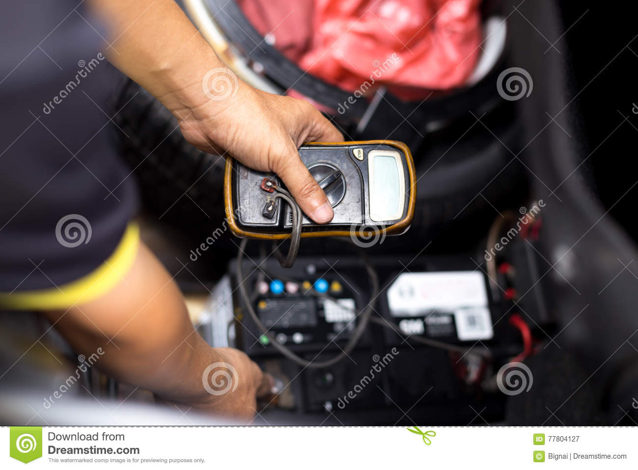 Mechanic Checking A Car Battery Level With Voltmeter Stock Image Electronic Voltmeters Download Of Hand