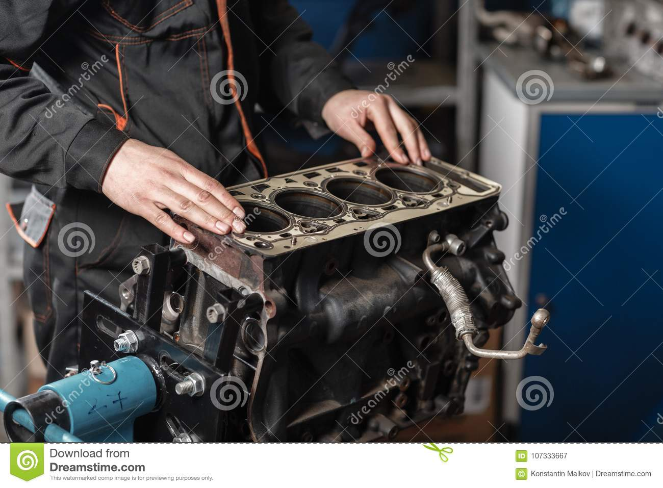 the mechanic disassemble block engine vehicle  engine on a repair stand  with piston and connecting