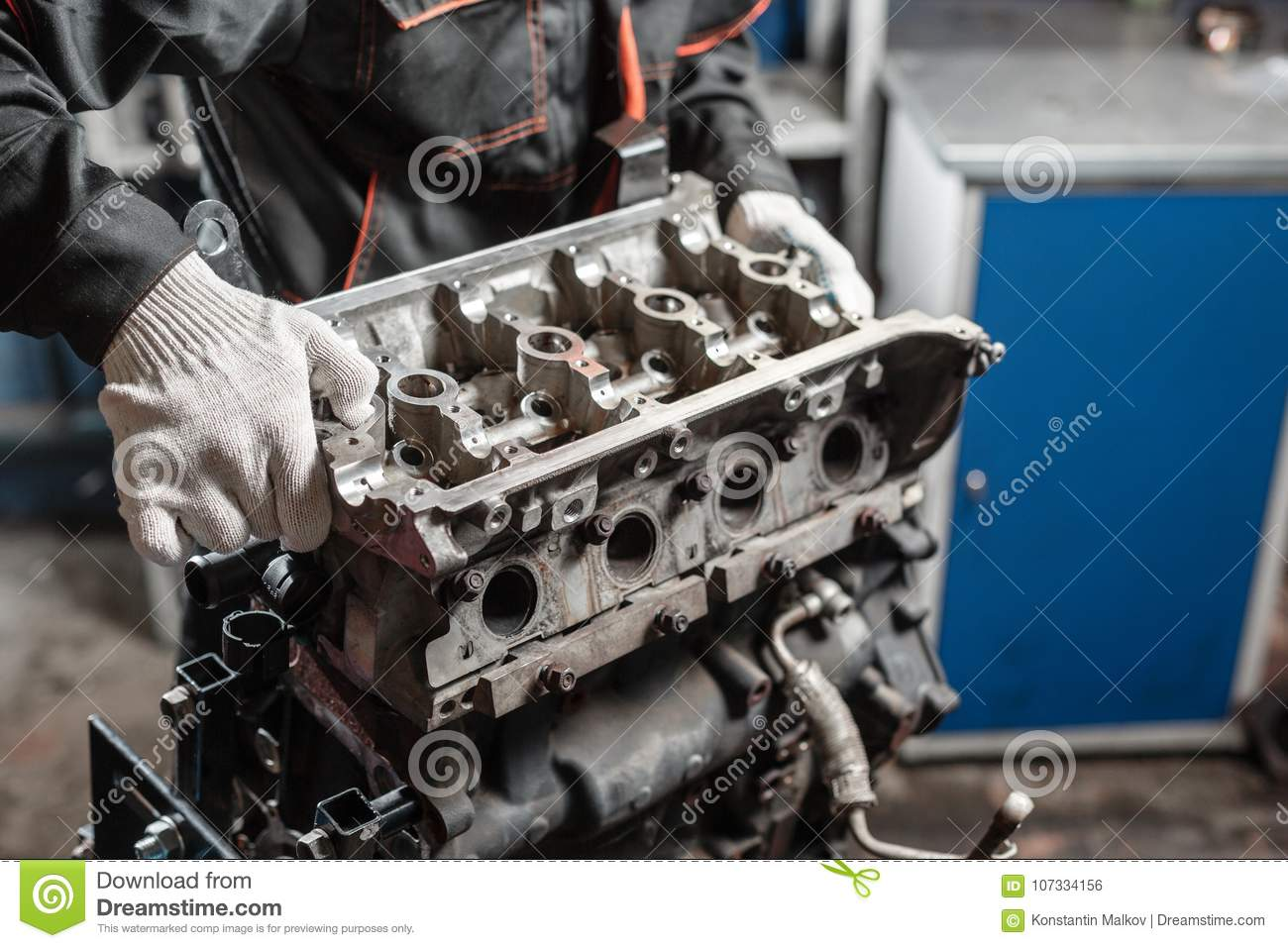 The mechanic disassemble block engine vehicle. Engine on a repair stand  with piston and connecting