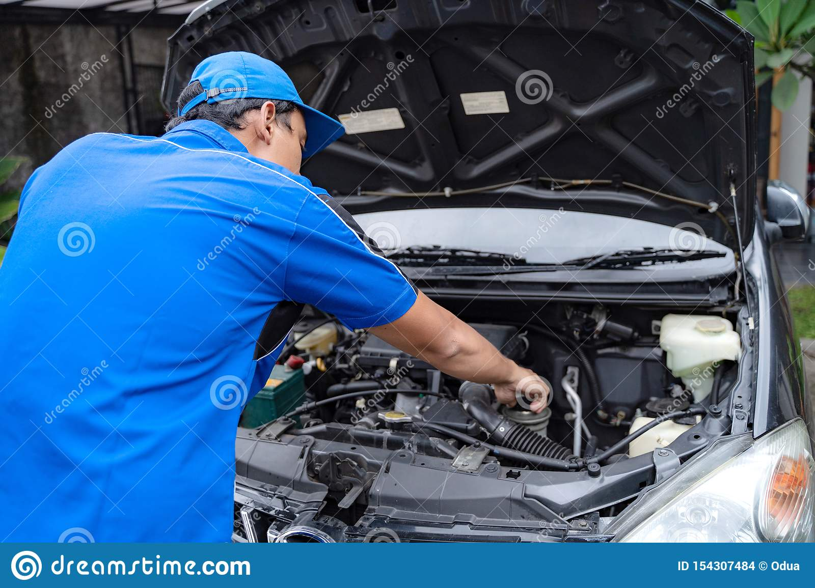 Mechanic Doing Some Inspection On Car S Engine Stock Photo Image Of Inspecting Coveralls 154307484